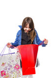 Portrait of a curious beautiful girl looking in the shopping bag Royalty Free Stock Images