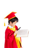 Portrait Of Curious Boy In Red Gown Kid Graduation With Mortarbo Stock Images