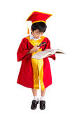 Portrait Of Curious Boy In Red Gown Kid Graduation With Mortarbo Royalty Free Stock Photo