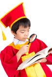 Portrait Of Curious Boy In Red Gown Kid Graduation With Mortarbo Royalty Free Stock Images