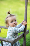 Portrait of a curious little girl with ponytail. Portrait of a curious little girl close-up outdoors Royalty Free Stock Photo