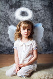 Portrait of curly girl with angel wings Stock Photography