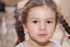 Portrait curly girl with pigtails Royalty Free Stock Images