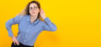 Woman listening to something Royalty Free Stock Image
