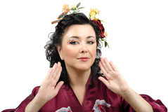 Portrait of the curly kimono woman with flowers in her hair Royalty Free Stock Image