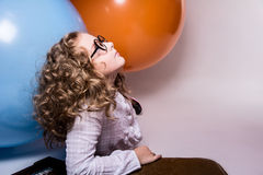 Portrait of curly teen girl in glasses on the background of larg Stock Photography