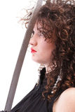 Portrait curly woman curly girl and sword Stock Photography