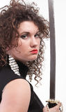 Portrait curly woman curly girl and sword Royalty Free Stock Images