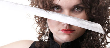 Portrait curly woman curly girl and sword Royalty Free Stock Photo