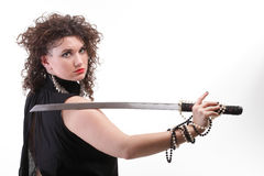 Portrait curly woman curly girl and sword Stock Photo