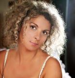 Portrait curly woman wearing ligerie Stock Photo