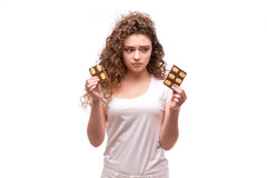 Portrait of curly young woman eating a chocolate bar. Against a white background Stock Image