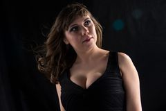 Portrait of curvy woman with flowing hair Royalty Free Stock Images