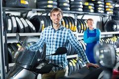 Portrait of customer choosing new motorbike in workshop Royalty Free Stock Photos