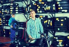 Portrait of customer choosing new motorbike in workshop Stock Images
