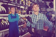 Portrait of customer choosing new motorbike in workshop Stock Photos