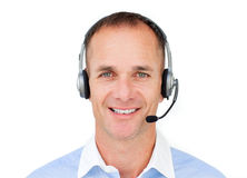 Portrait of a Customer service agent. Talking on headset against a white background Royalty Free Stock Photography
