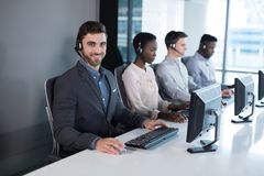 Customer service executives working at office. Portrait of customer service executives working at office royalty free stock photos