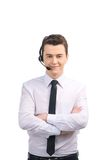 Portrait of customer service representative standing arms crossed. Stock Images