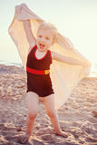 Portrait of cute adorable happy smiling toddler little girl with towel on beach making poses faces having fun Royalty Free Stock Photos