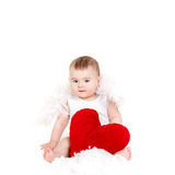 Portrait of a Cute adorable little valentine angel with red soft heart isolated on white background Stock Photo
