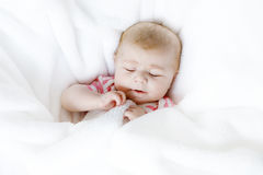 Portrait of cute adorable newborn baby child sleeping Stock Image