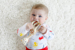 Portrait of cute adorable newborn baby child with toy Royalty Free Stock Images
