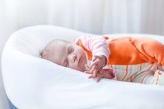 Portrait of cute adorable newborn baby girl sleeping Stock Image