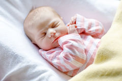 Portrait of cute adorable newborn baby girl sleeping Stock Photography