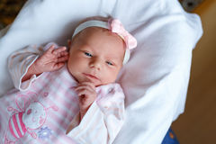 Portrait of cute adorable newborn baby girl sleeping Stock Photos
