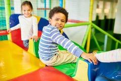 Little Boy Enjoying Slides royalty free stock images