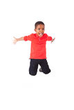 Portrait of a cute african american little boy jumping, isolated. On white background Stock Image