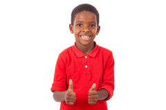 Portrait of a cute african american little boy making thumbs up Stock Photo