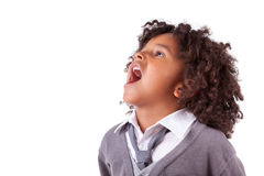 Portrait of a cute african little boy screaming. Isolated on white background Royalty Free Stock Images