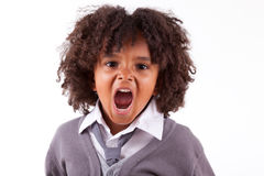 Portrait of a cute african little boy screaming. Isolated on white background Stock Photo