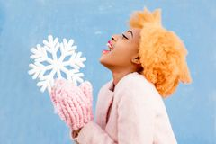 Portrait of a woman with artificial snowflake on the blue background Stock Photos