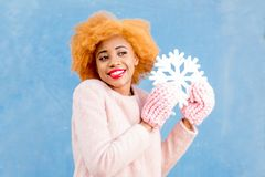 Portrait of a woman with artificial snowflake on the blue background Stock Image