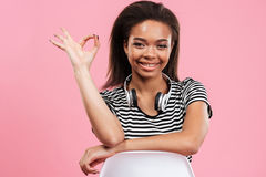 Portrait of a cute afro american girl showing ok gesture Stock Image