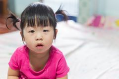 Portrait of a cute Asian child girl and looking aside Royalty Free Stock Photography