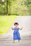 Portrait of cute Asian child playing in park Royalty Free Stock Images
