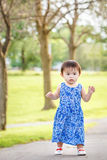 Portrait of cute Asian child playing in park Stock Images