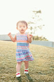Portrait of cute Asian child playing in park royalty free stock photo