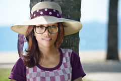 Portrait of a cute Asian girl in a hat   Stock Photography