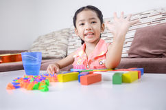 Portrait of cute asian little girl playing brick on table at hom Stock Photography