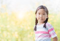 Portrait of cute asian little girl smile. On nature background Stock Photos