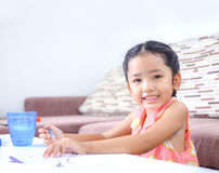 Portrait of cute asian little girl Thai painting the color at ho Royalty Free Stock Photography