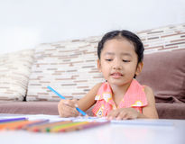 Portrait of cute asian little girl Thai painting the color at ho Stock Images