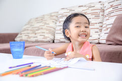 Portrait of cute asian little girl Thai smile and painting the c Stock Photos