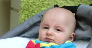 Portrait of a Cute Baby Boy Wearing Funny Costume. Portrait of a Cute Baby Boy Five Month Old Wearing Funny Costume in His Pram. Close Up View - DCi 4K stock footage