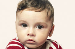 Portrait of a cute baby boy looking at the camera. Royalty Free Stock Image